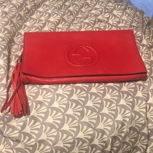 Authentic Gucci soho clutch .